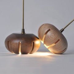 Wooden flower petal strip on copper wire pendant light light wood close up