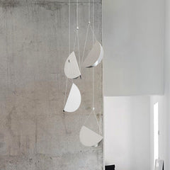 White glider pendant light chandelier room setting