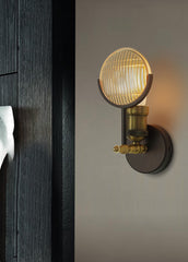 Huberman fresnal lens wall light sconce