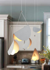 White glider pendant light chandelier kitchen setting