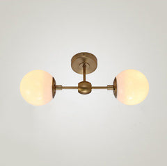 Brushed brass frost bulb wall light sconce
