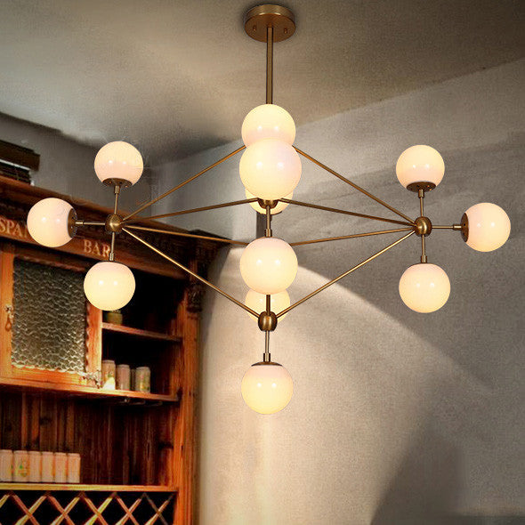 Brushed brass chandelier with frosted bulb cluster