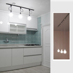 Track hanging lights for kitchen island or shop display.