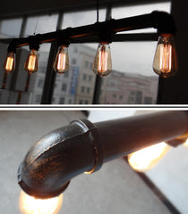 Hanging ceiling metal pipe light in black