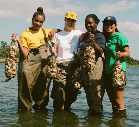 Image of environmentalists with oysters