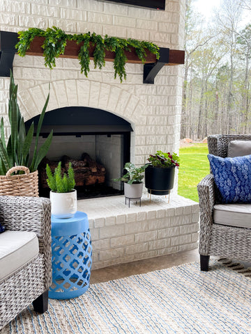 accent table, lattice table, outdoor stool, fireplace, outdoor furniture, pillows, planters, spring patio