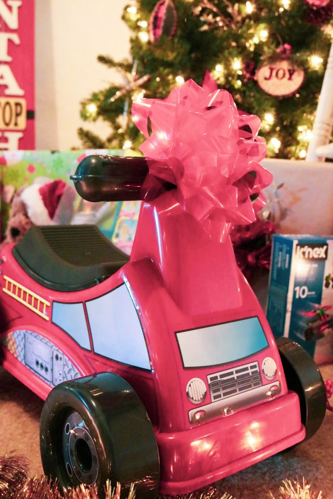 A pretty pink ride-along toy