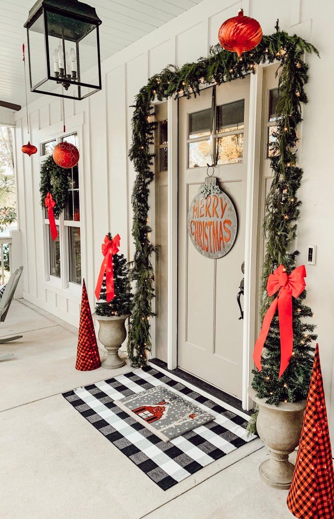Beautiful Christmas ornaments hanging from a porch