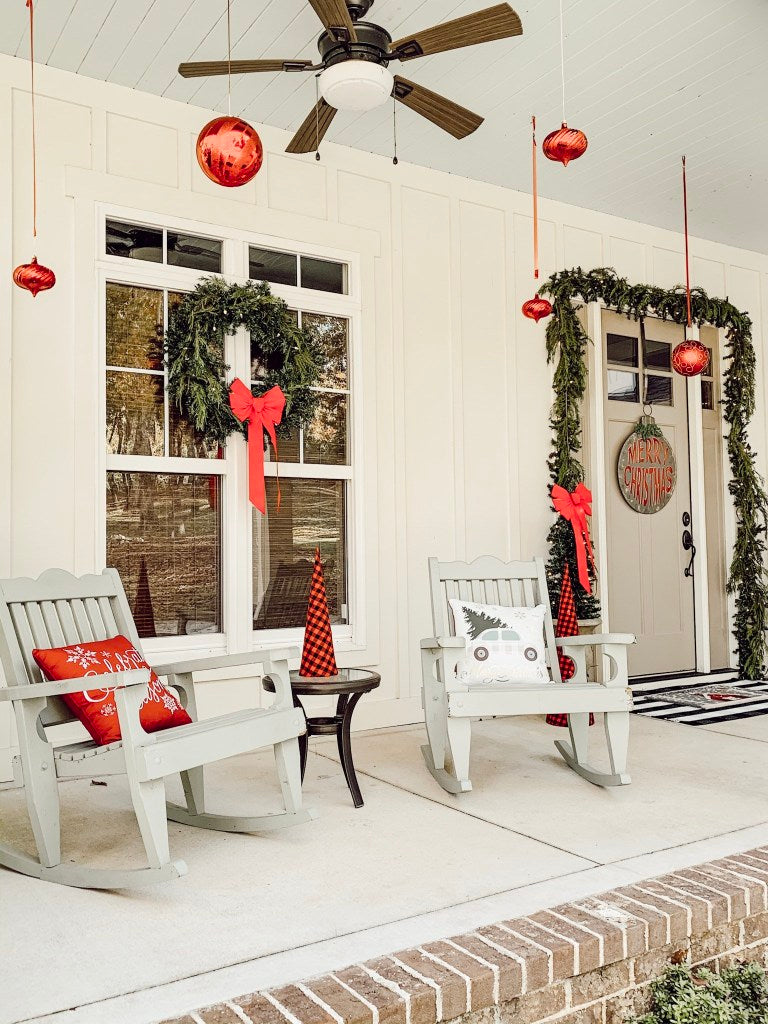 Peppermints and ornaments abound on this cute porch