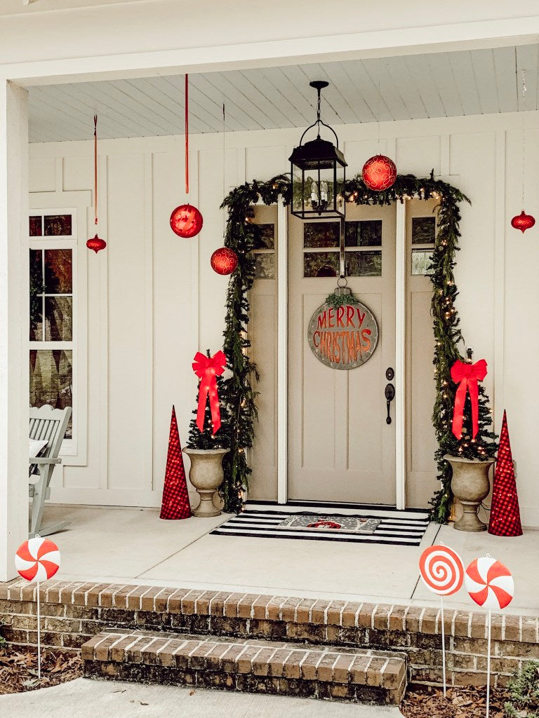 A front door adorned with decorations for the holidays