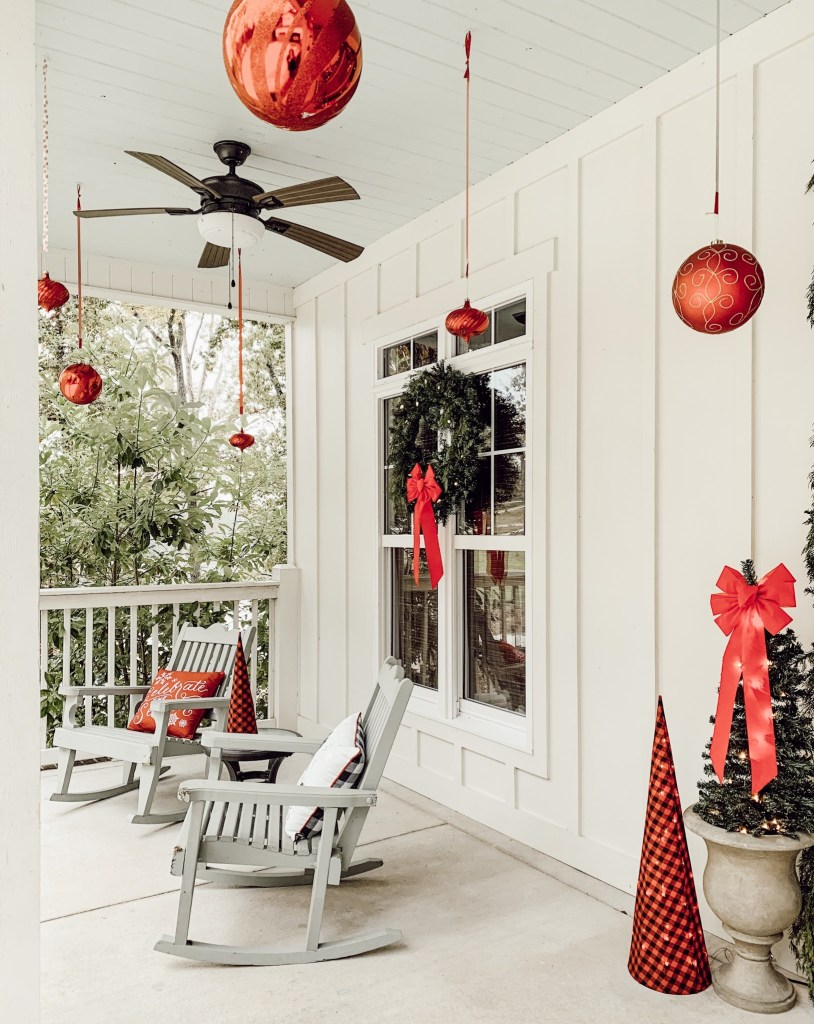 Two cozy rocking chairs in a winter wonderland-themed porch