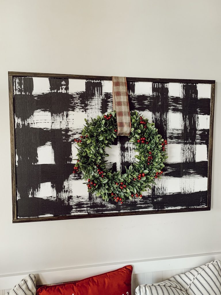 DIY plaid wall art hanging with a wreath