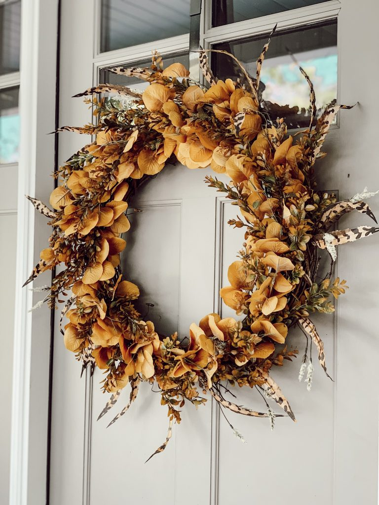 this autumn wreath adds so much warmth to this home
