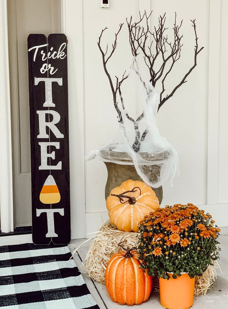 pumpkins, mums, planter, doormat spiderweb decor