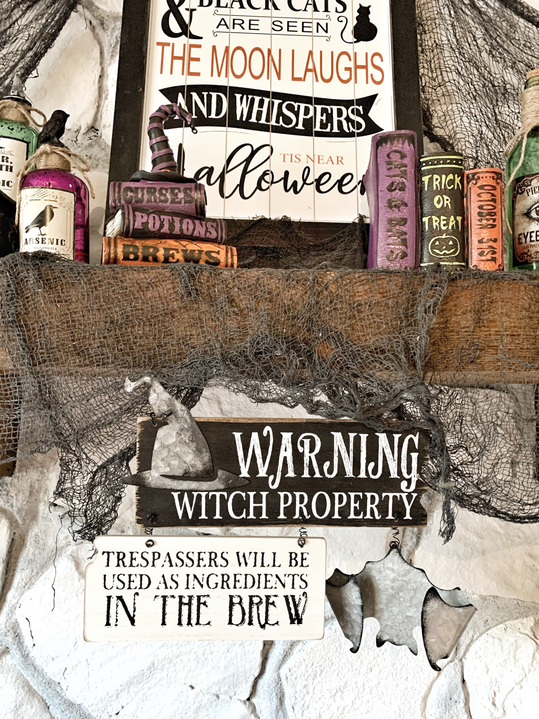 A wooden sign reads: Trespassers will be used as ingredients in the brew