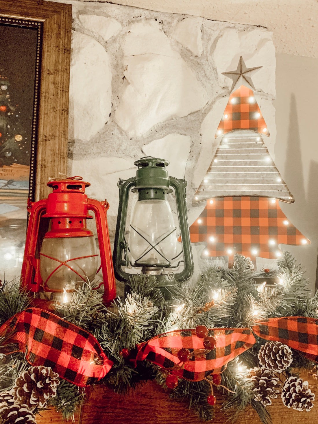 lanterns add an extra touch to this holiday fireplace