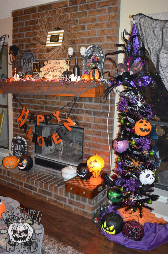 A Halloween-themed fire place display