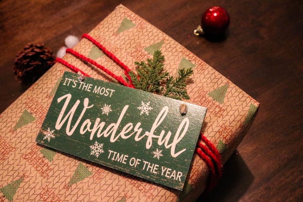 A package with a cute wooden sign: It's the most wonderful time of the year