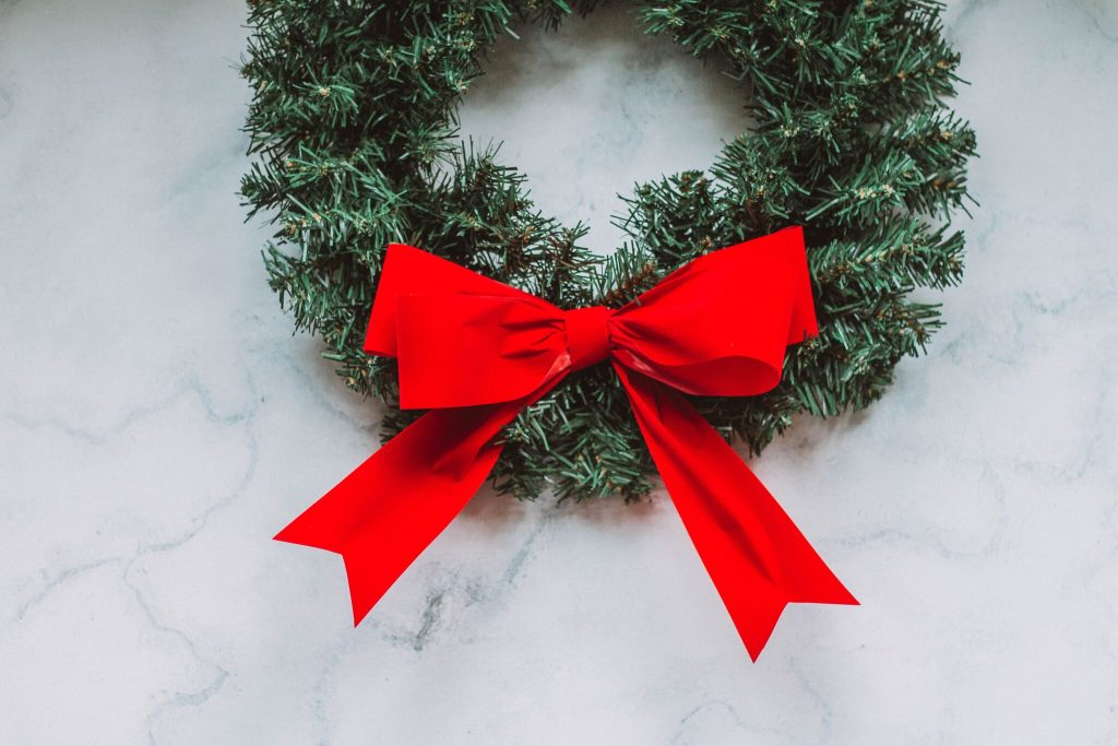 A bright red bow on a wreath