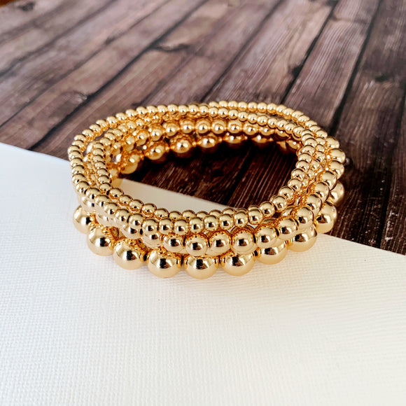 Boutique Bracelet Collection :: Nora Polished Gold Stacked Ball Bracelets