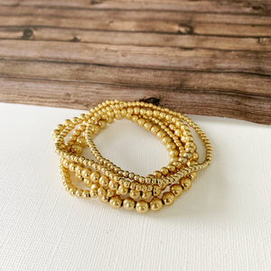 Boutique Bracelet Collection :: Nora Petite Matte Gold Ball Bracelets