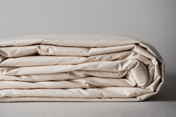 Organic cotton duvet cover in natural color folded for storage