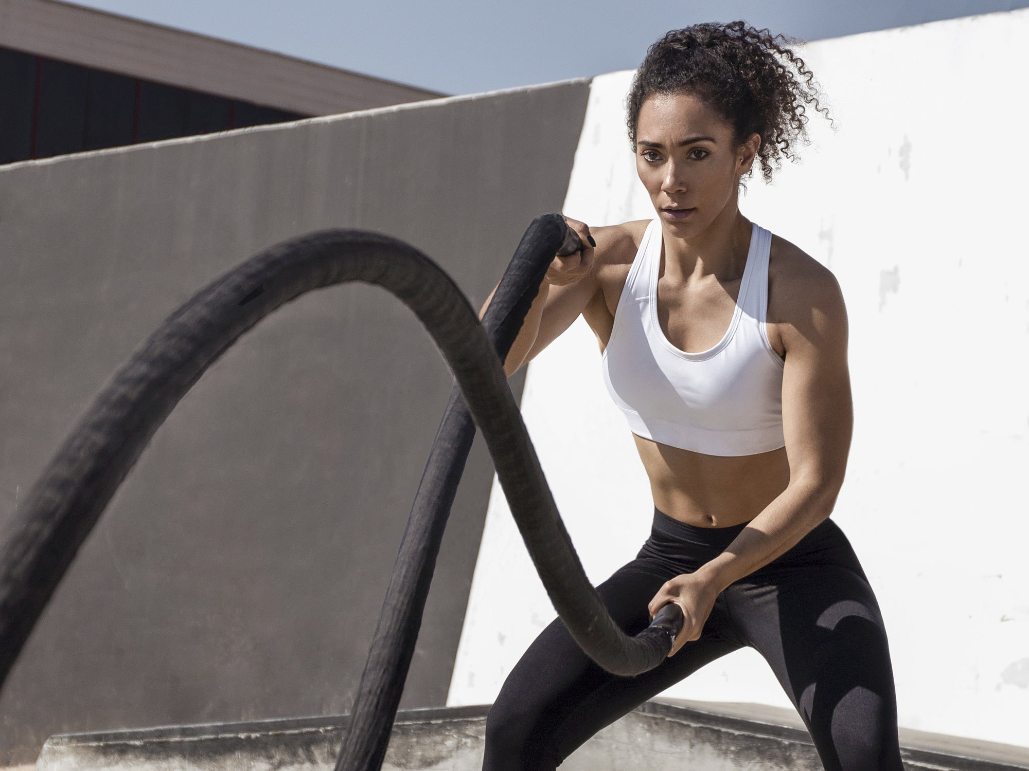 woman upper body workout with battle ropes