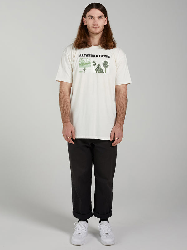 100% Cotton, screen printed mens t-shirt by Lucie Marquis. Photo Mount Maunganui, New Zealand.