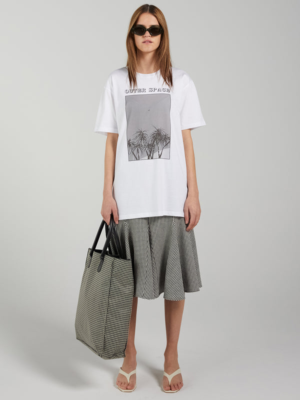 100% Cotton, screen printed womens t-shirt by Lucie Marquis. Photo Auckland, New Zealand.