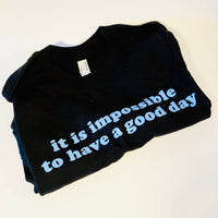 It is Impossible to Have a Good Day Unisex Tee, Black