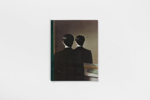 A book with a green spine and a painting of a figure and the figure's reflection in the mirror