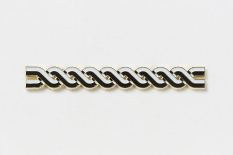 A long rectangular pin of black and white lines twisted around each other
