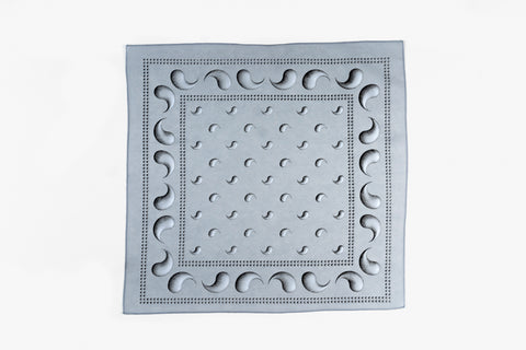 A grey square bandana with a black and white gradated design