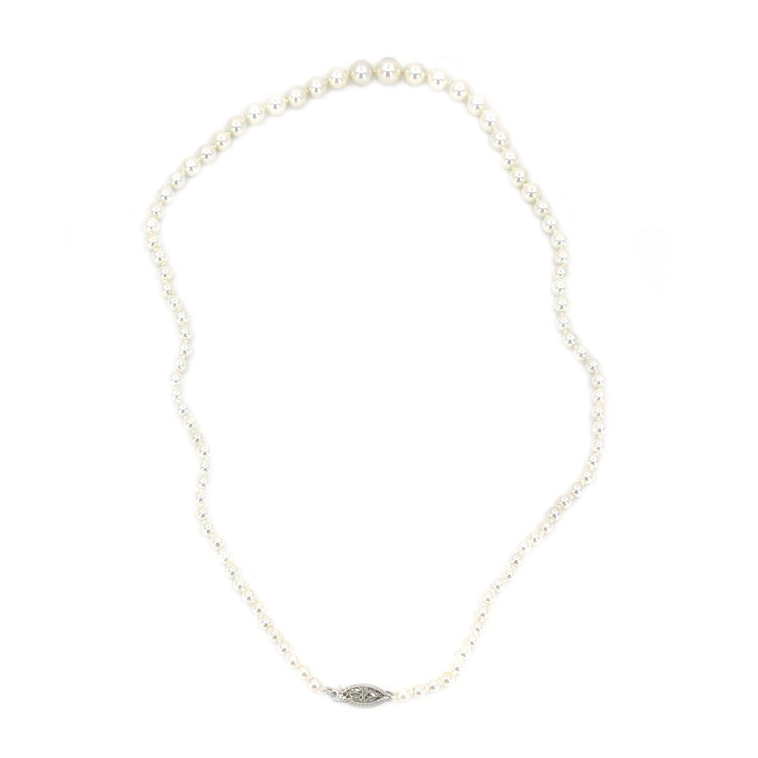 "This is a stunning example of a classic Japanese akoya saltwater cultured pearl necklace.  The pearls are graduated and range from 3.00-7.00mm. They are round with excellent luster and sharp rosy overtones. The have almost no blemishes.  Clasp is in solid yellow gold and is a filigree design. It is stamped ""14K"".  Total length is 17.50 inches.  All pearls are truly vintage and have only been lightly cleaned and restrung."