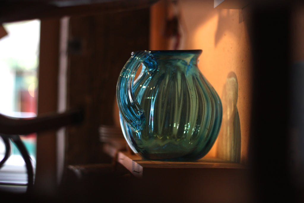 A blue glass pitcher at Catala Antiquités