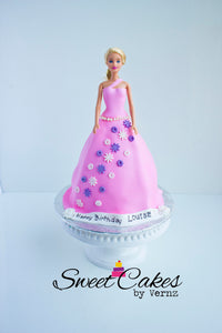 This is an amazing birthday cake that we have in our special cakes collection. Our cakes are locally made in Calgary. If your daughter is looking for a themed Barbie Doll cake, this is it! Order today!