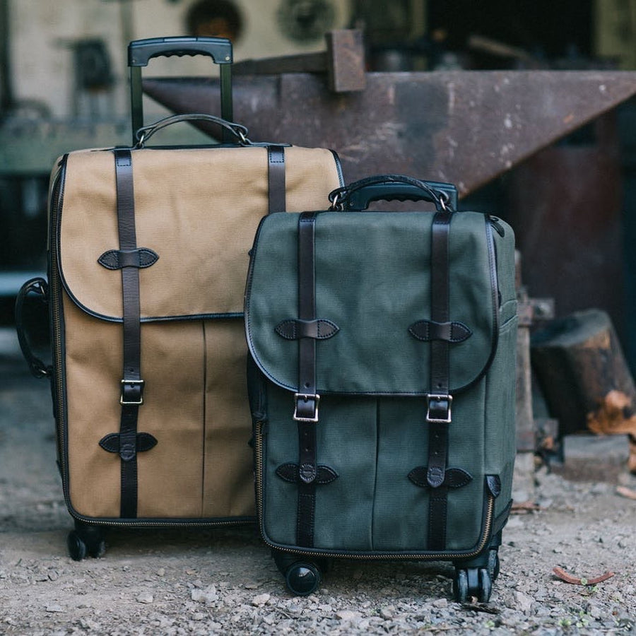 Rolling 4-Wheel Check In Bag | Tan