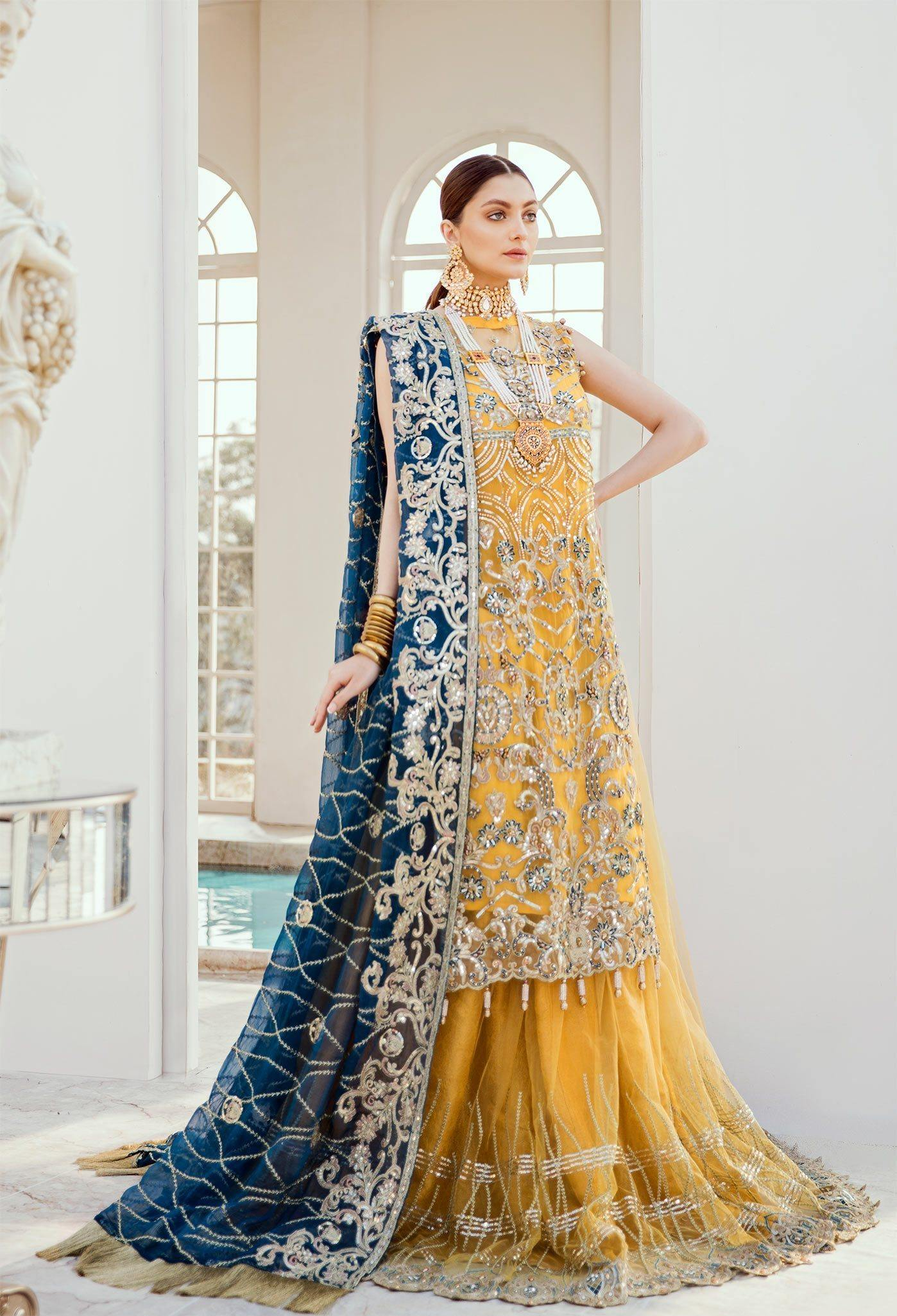 Bridal Lehenga - Exotic Deep (D-03) - Maryum N Maria | A female model wearing a stunning and beautiful Bridal Dress and posing for the Photoshoot of Maryum N Maria Bridal Dresses Collection