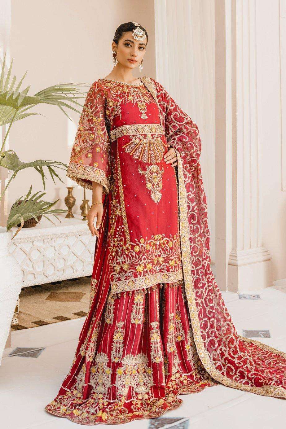 A female model wearing a stunning and beautiful Formal Lehenga and posing for the Photoshoot of Mashq's Formal Wear Collection