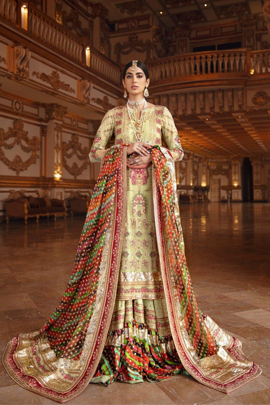 A female model wearing a stunning and beautiful Formal Wedding Gharara and posing for the Photoshoot of Maryum N Maria Formal Wedding Dresses Collection