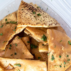 View of Open Container of Bab Small Batch Pita Chips. Get ready to crunch!