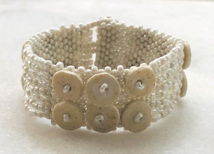 PEARL-COLORED 2-ROW SKOONHEID OSTRICH EGG SHELL BEADED BRACELET — BY OMBA ARTS TRUST