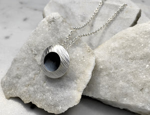 EMMA TALLACK JEWELRY —  Handcrafted Double-Domed, Brushed Sterling Silver, Hammer-Textured Pendant with Oxidized Center