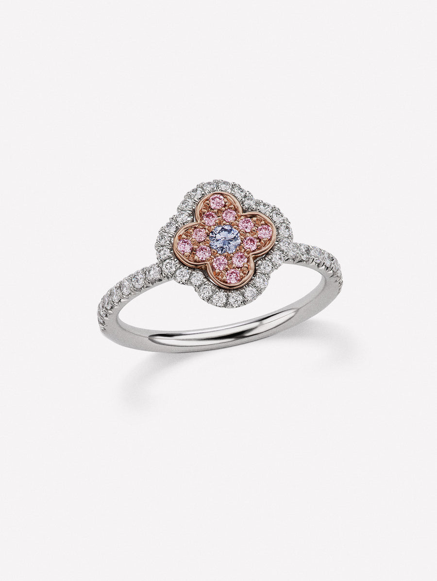 Argyle pink diamond ring in J Fine azalea design with blue diamond center and white diamond halo