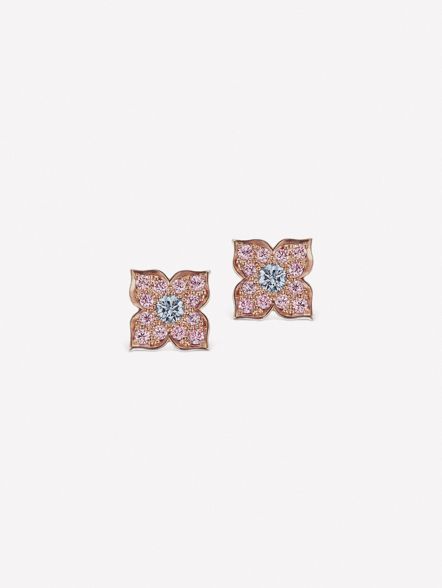 Pink diamond stud earrings with blue diamond center created by J Fine in its floral azalea design
