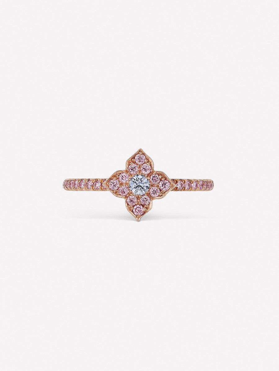 Pink diamond ring with blue diamond at the center of J Fine floral azalea design