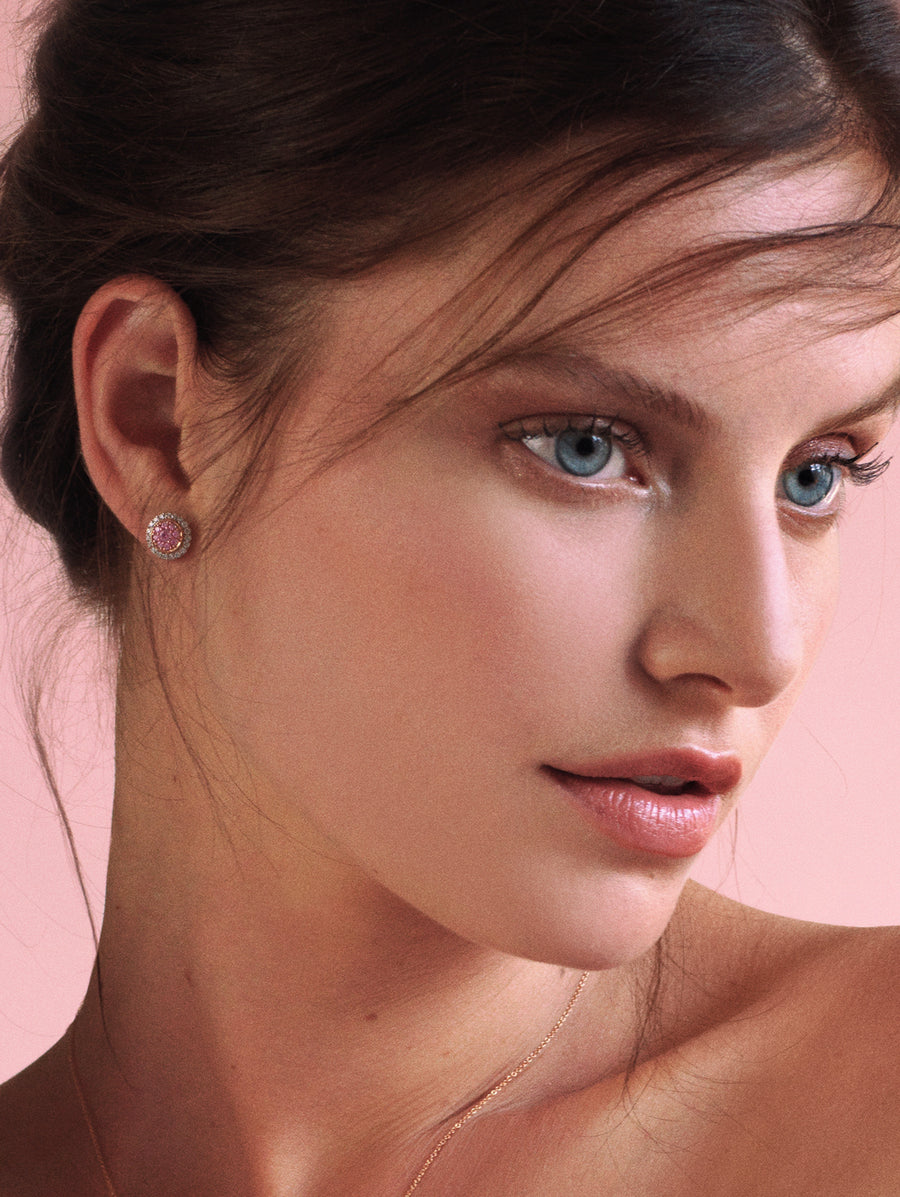 Woman wearing J Fine Argyle Pink™ Diamond Double Halo Studs | natural pink diamonds