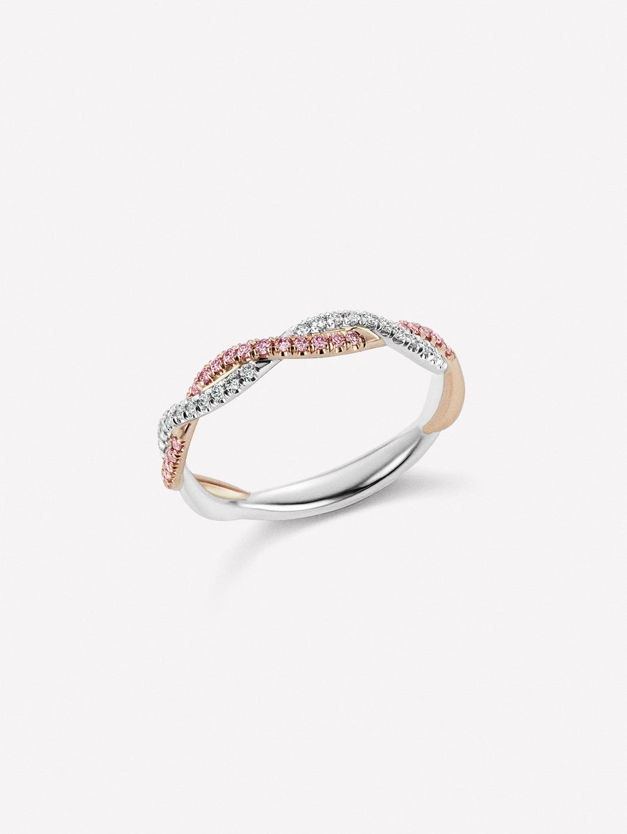 Pink and white diamond ring in braided band design