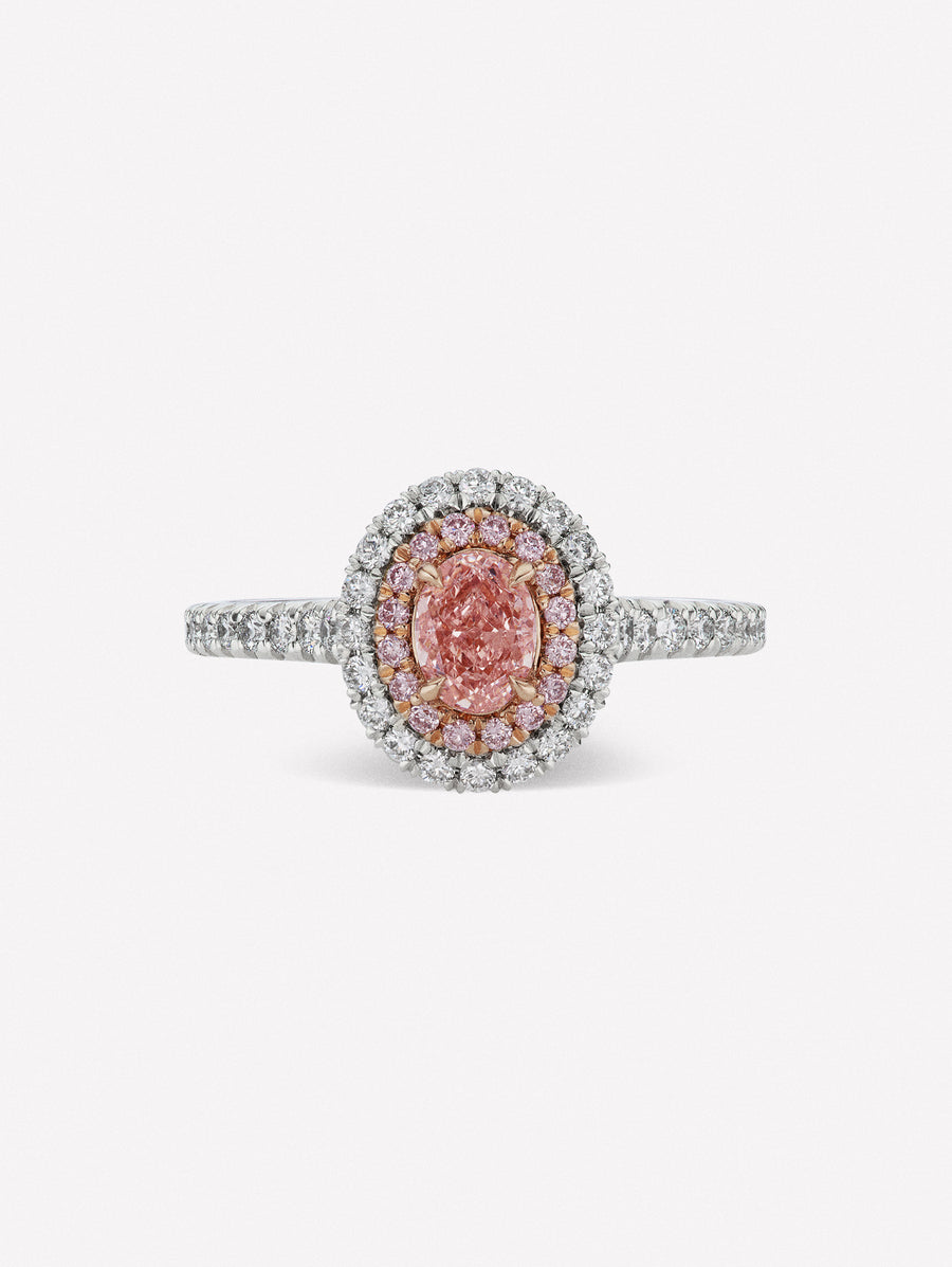 Oval shape fancy pink diamond halo ring by J F I N E .