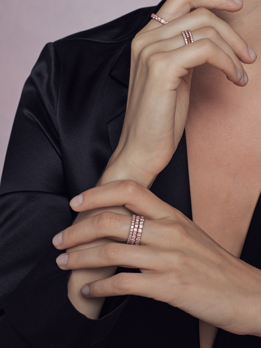 Fashion model wearing Argyle pink diamond eternity band in rose gold by J F I N E.